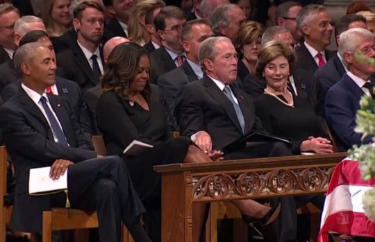 George Bush handed sweets to Michelle Obama at John McCain funeral