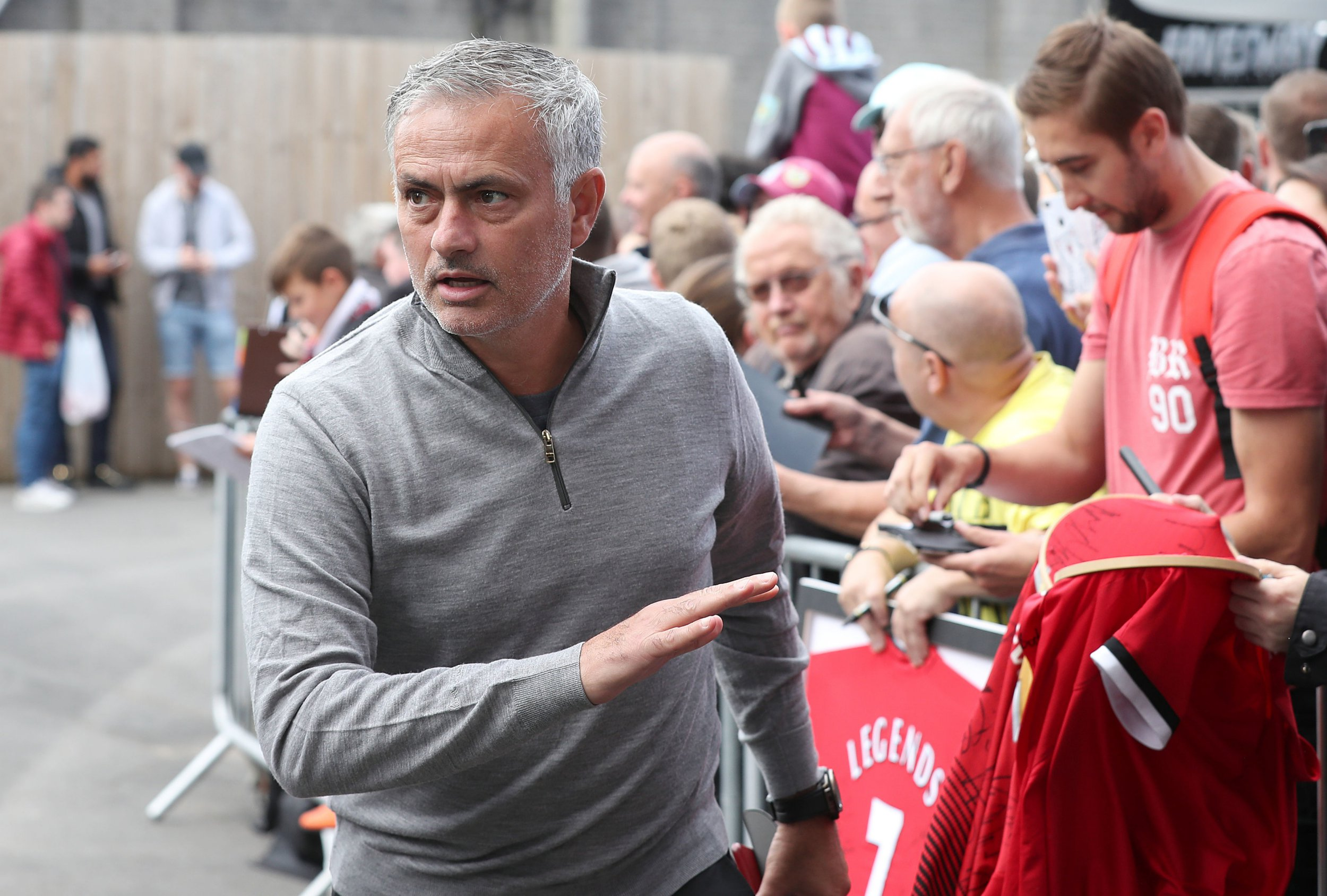 "Manchester United manager Jose Mourinho signs autographs for fans before the Premier League match at Turf Moor, Burnley. PRESS ASSOCIATION Photo. Picture date: Sunday September 2, 2018. See PA story SOCCER Burnley. Photo credit should read: Martin Rickett/PA Wire. RESTRICTIONS: EDITORIAL USE ONLY No use with unauthorised audio, video, data, fixture lists, club/league logos or ""live"" services. Online in-match use limited to 120 images, no video emulation. No use in betting, games or single club/league/player publications."