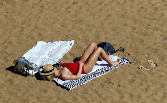 A woman relaxes on the beach in Broadstairs, Kent PRESS ASSOCIATION Photo. Picture date: Sunday September 2, 2018. Photo credit should read: Gareth Fuller/PA Wire