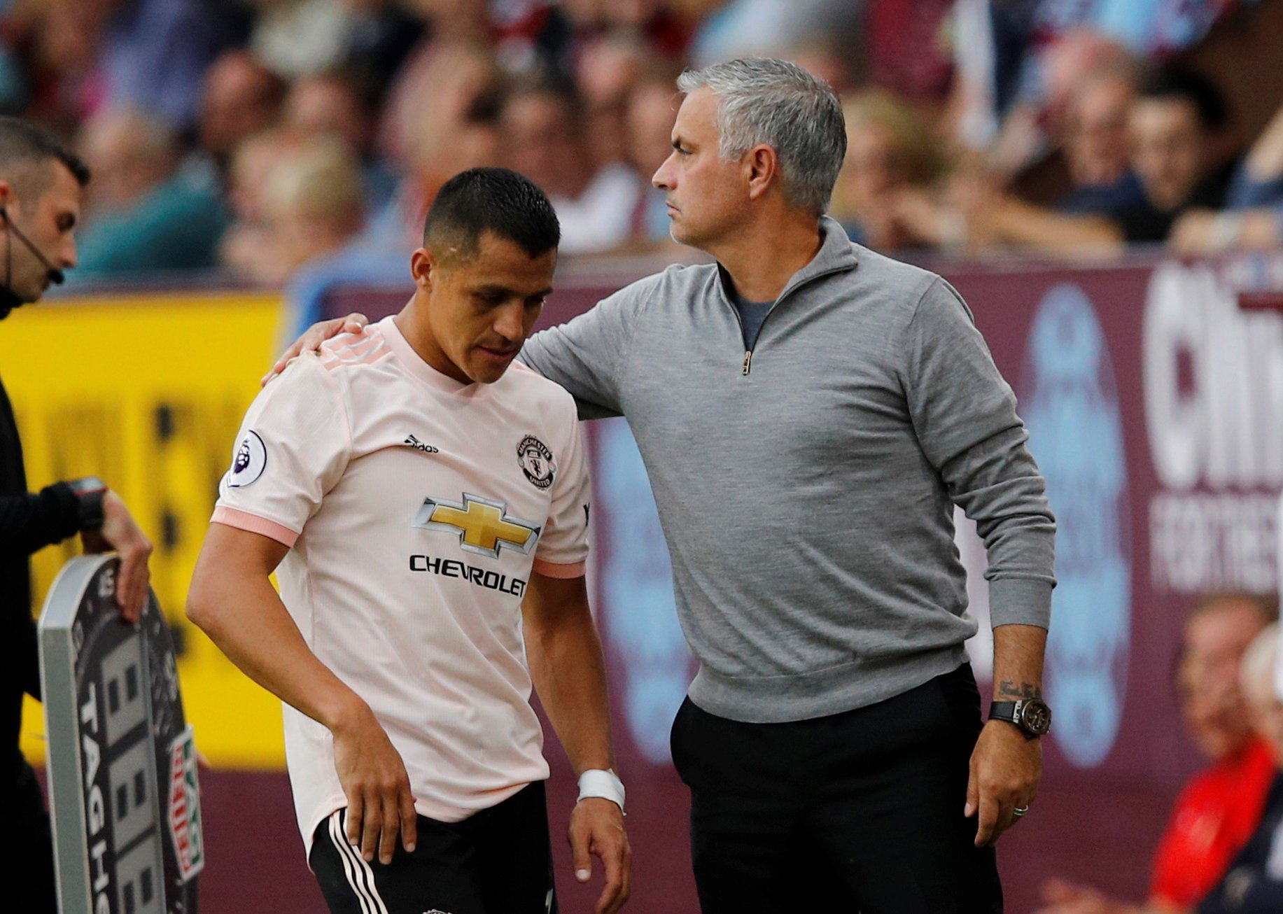 "Soccer Football - Premier League - Burnley v Manchester United - Turf Moor, Burnley, Britain - September 2, 2018 Manchester United's Alexis Sanchez with manager Jose Mourinho as he is substituted off REUTERS/Phil Noble EDITORIAL USE ONLY. No use with unauthorized audio, video, data, fixture lists, club/league logos or ""live"" services. Online in-match use limited to 75 images, no video emulation. No use in betting, games or single club/league/player publications. Please contact your account representative for further details."