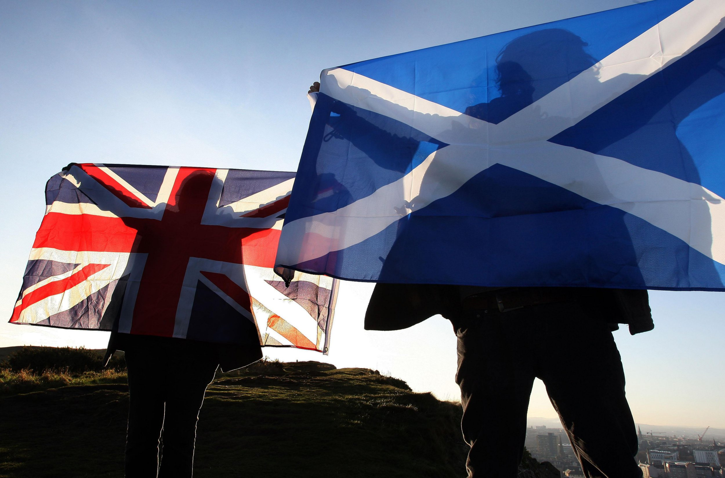 """Two men wave a Union and Saltire flags in Edinburgh, Scotland. Scotland's First Minister Alex Salmond said today that he was ready to meet Prime Minister David Cameron """"in Edinburgh, in London or wherever"""" to discuss the way forward for a referendum on independence."""