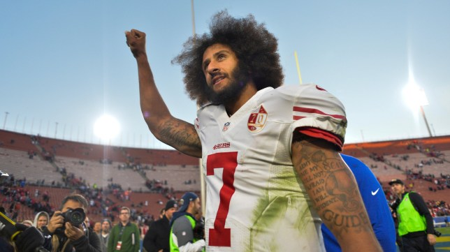af2ea1544841b FILE PHOTO - San Francisco 49ers quarterback Colin Kaepernick pumps his  fist as he acknowledges the