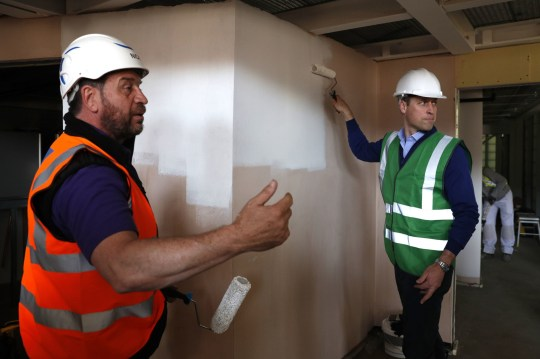 The Duke of Cambridge (right) with presenter Nick Knowles as he joins the crew of DIY SOS in Ladbroke Grove, west London, on a major project to support people affected by the devastating fire at Grenfell Tower.