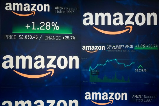 Amazon stock price is shown on an electronic screen at the Nasdaq MarketSite, Tuesday, Sept. 4, 2018, in New York. Amazon became the second publicly traded company to be worth $1 trillion, hot on the heels of Apple. (AP Photo/Mark Lennihan)