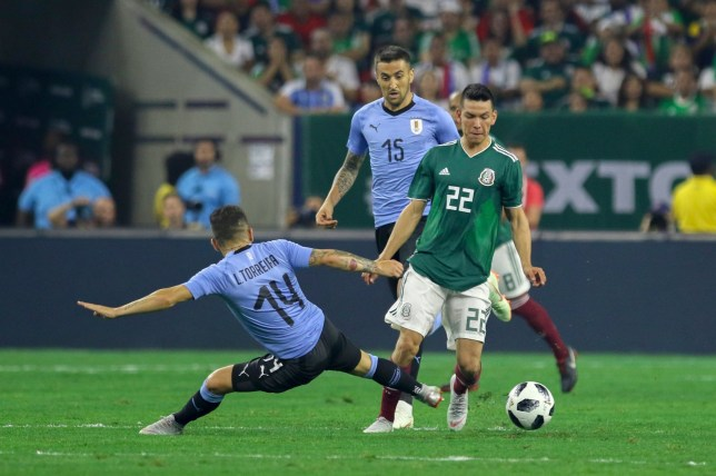 SIPA USA via PA Images Sep 7, 2018; Houston, TX, USA; Uruguay midfielder Lucas Torreira (14) slides for the ball against Mexico forward Hirving Lozano (22) during the first half at NRG Stadium. Mandatory Credit: John Glaser-USA TODAY Sports