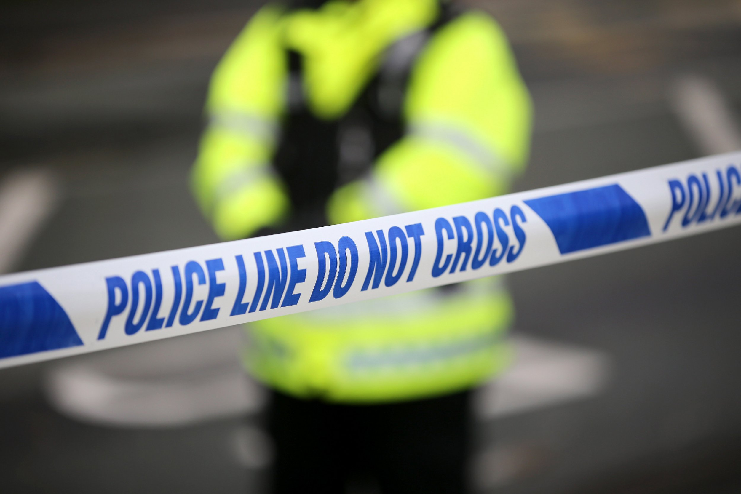 MANCHESTER, ENGLAND - SEPTEMBER 19: Police tape cordons off the scene of the shooting of WPC's Nicola Hughes and Fiona Bone in Hattersley on September 19, 2012 in Manchester, England. Local man Dale Cregan, 29, has been arrested in connection with the shooting of WPC's Nicola Hughes and Fiona Bone, who were killed as they responded to a routine incident at Abbey Gardens in Hattersley shortly before 11am yesterday. (Photo by Christopher Furlong/Getty Images)