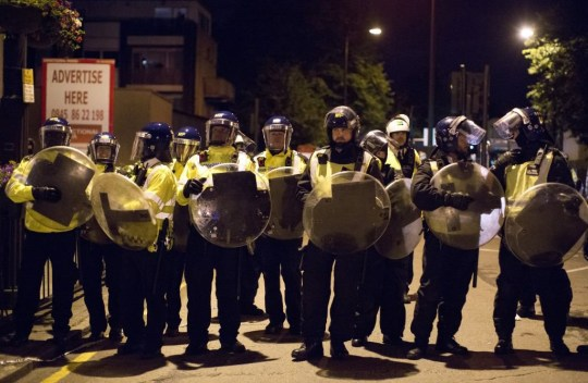 LONDON, UNITED KINGDOM - JUNE 26: Protesters clash with riot police in Romford Road, east London, United Kingdom, on June 26, 2017. Tensions spiralled on the streets of east London following the death of 25-year-old Edir Frederico Da Costa who died six days after he was stopped by police and detained. (Photo by Isabel Infantes/Anadolu Agency/Getty Images)