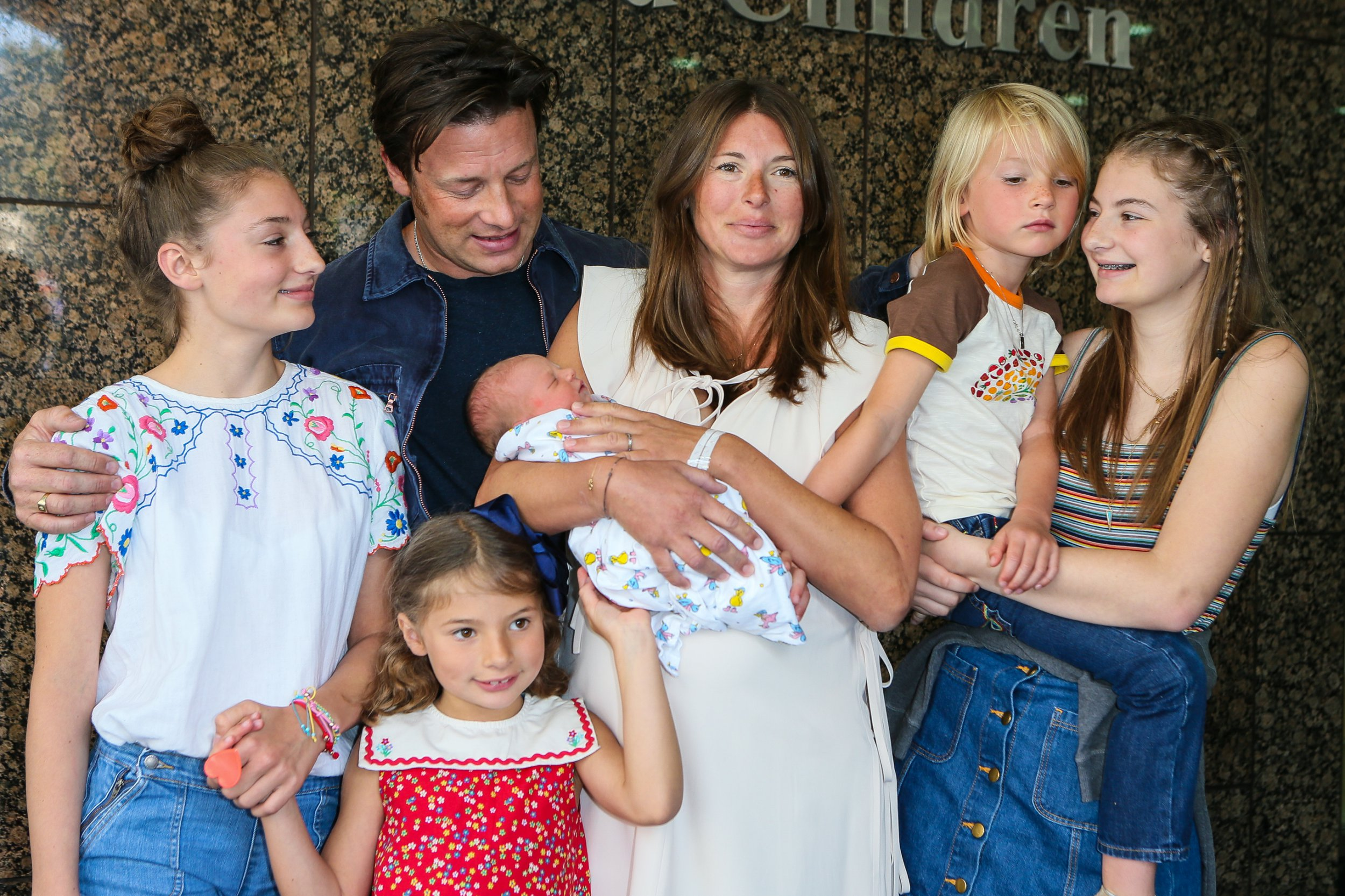 Jamie Oliver, Jools Oliver and their family pose with their new baby at The Portland Street Hospital on August 8, 2016 in London, England.