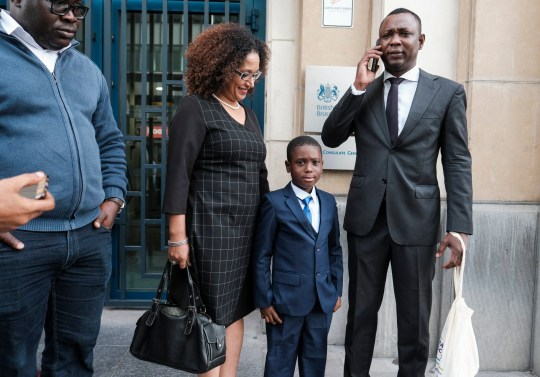 epa07010202 British-born six-year-old Mohamed Barrak Diallo Bangoura poses with his new passport and relatives in front of the British Embassy in Brussels, Belgium, 10 September 2018. Belgian authorities on 02 September rejected the boy's British passport and prevented him from returning home to his mother following a holiday. According to reports, the British Home Office had instructed Belgian airport police that Mohamed's passport was no longer valid and had to be revoked. Members of the British and Eureopean parliaments demanded that the boy receives a new travel document to join his mother in Sheffield. EPA/OLIVIER HOSLET