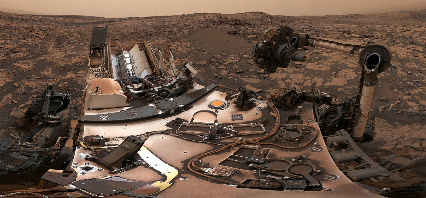 "This 360-degree panorama was taken on Aug. 9 by NASA's Curiosity rover at its location on Vera Rubin Ridge. Credits: NASA/JPL-Caltech/MSSS Full image and caption After snagging a new rock sample on Aug. 9, NASA's Curiosity rover surveyed its surroundings on Mars, producing a 360-degree panorama of its current location on Vera Rubin Ridge. The panorama includes umber skies, darkened by a fading global dust storm. It also includes a rare view by the Mast Camera of the rover itself, revealing a thin layer of dust on Curiosity's deck. In the foreground is the rover's most recent drill target, named ""Stoer"" after a town in Scotland near where important discoveries about early life on Earth were made in lakebed sediments. The new drill sample delighted Curiosity's science team, because the rover's last two drill attempts were thwarted by unexpectedly hard rocks. Curiosity started using a new drill method earlier this year to work around a mechanical problem. Testing has shown it to be as effective at drilling rocks as the old method, suggesting the hard rocks would have posed a problem no matter which method was used."