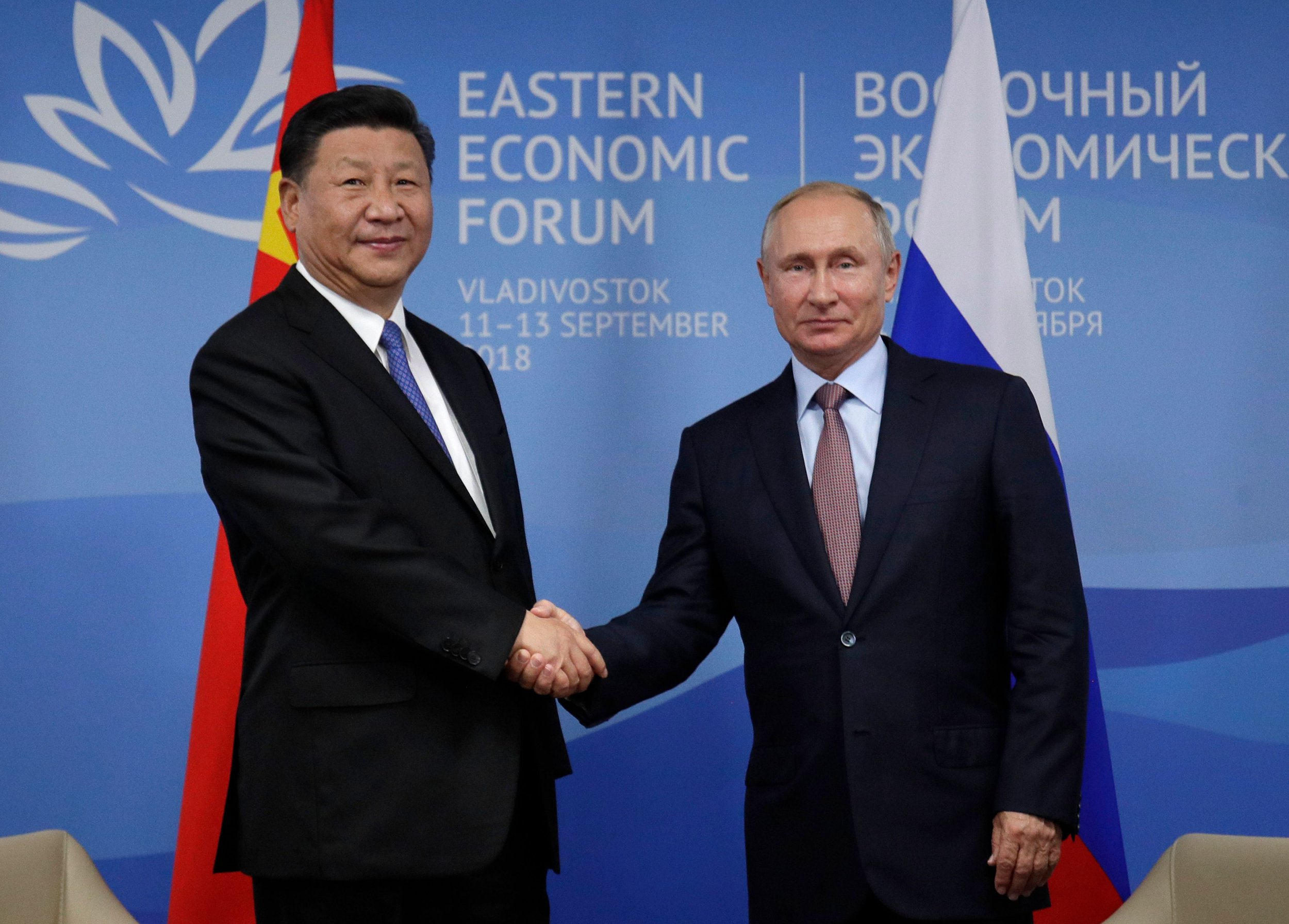 Russian President Vladimir Putin (R) meets with his Chinese counterpart Xi Jinping on the sidelines of the Eastern Economic Forum in Vladivostok on September 11, 2018. (Photo by Dmitri Lovetsky / POOL / AFP)DMITRI LOVETSKY/AFP/Getty Images
