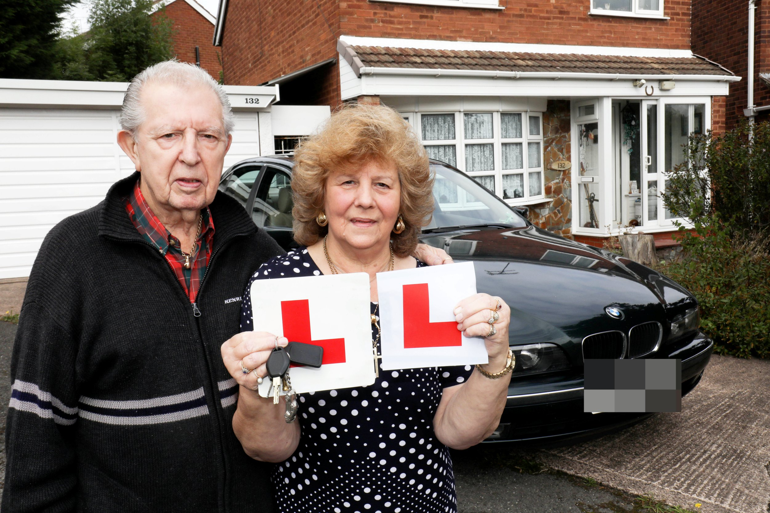 June Evans, 75, with her husband Brain, 83, from Birmingham, West Midlands. See NTI story NTIDRIVER. A pensioner has become one of the UK?s oldest to their pass driving test - after starting 50 years ago. June Evans, 75, was 24 when she first got behind the wheel ? but decided to pack it up not long after. The great gran-of-one, revealed it has taken her 36 years to get back in the driving seat ? after her sons Gary, 53, and Paul, 47 convinced her too. Husband Brian, 83, has been with June all the way through her journey ? even acting as her instructor. June, of Great Barr, Birmingham, had only ever had 25 lessons after starting again but opted for Brian being her teacher afterwards. The 75-year-old had taken her first driving in September 2017 and failed - she then took two more tests this year in April and July but sadly failed both. Fourth time lucky, she managed to finally pass her test on Tuesday, September 4 at the Kingstanding driving test centre, Birmingham.