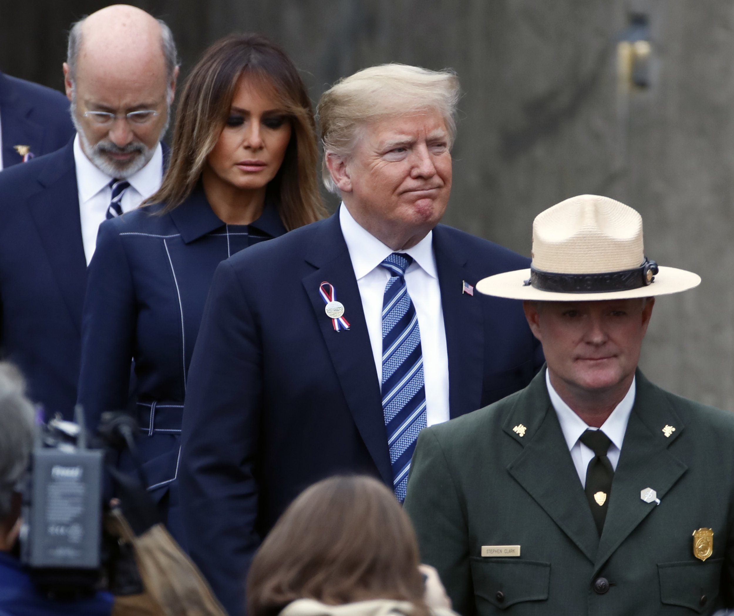 President Donald Trump, center and first lady Melania Trump, second from left, arrive with Pennsylvania Governor Tom Wolf, left rear, at the September 11th Flight 93 Memorial Service in Shanksville, Pa., Tuesday, Sept. 11, 2018. (AP Photo/Gene J. Puskar)