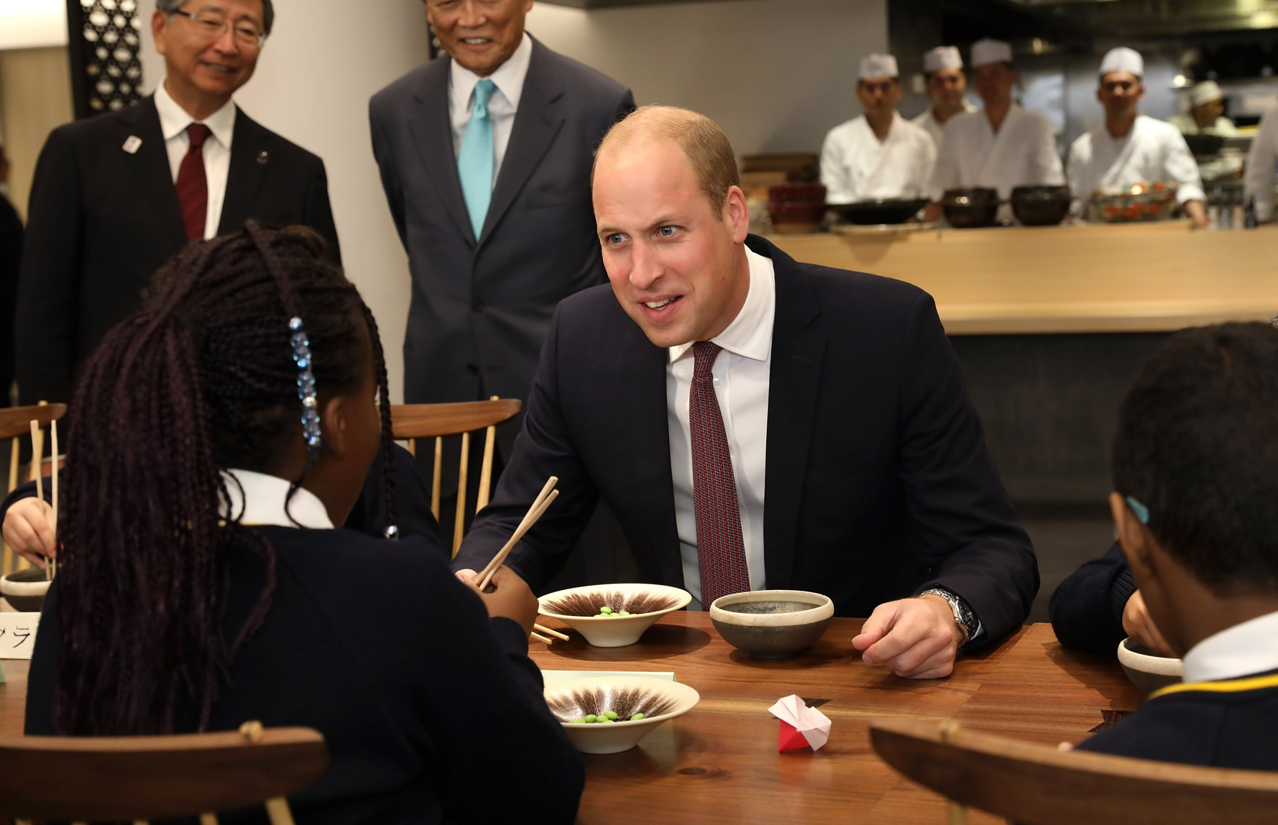 Duke of Cambridge joins in with local school children from St Cuthbert with St Matthias CE Primary School learning the art of using chopsticks during The Official Opening of Japan House London, the new Cultural Home of Japan in the UK. PRESS ASSOCIATION Photo. Picture date: Thursday September 13, 2018. See PA story ROYAL Japan. Photo credit should read: Tim P. Whitby/PA Wire