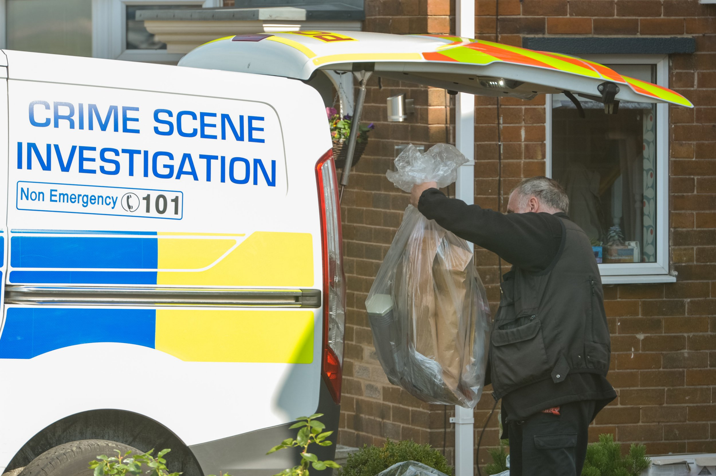 Police remove objects from inside the house where an 83 year old woman is suspected of murdering an 85 year old man (named locally as Alan Grayson), in the Handsworth area of Sheffield, South Yorks., September 13 2018. See Ross Parry story RPYMURDER: