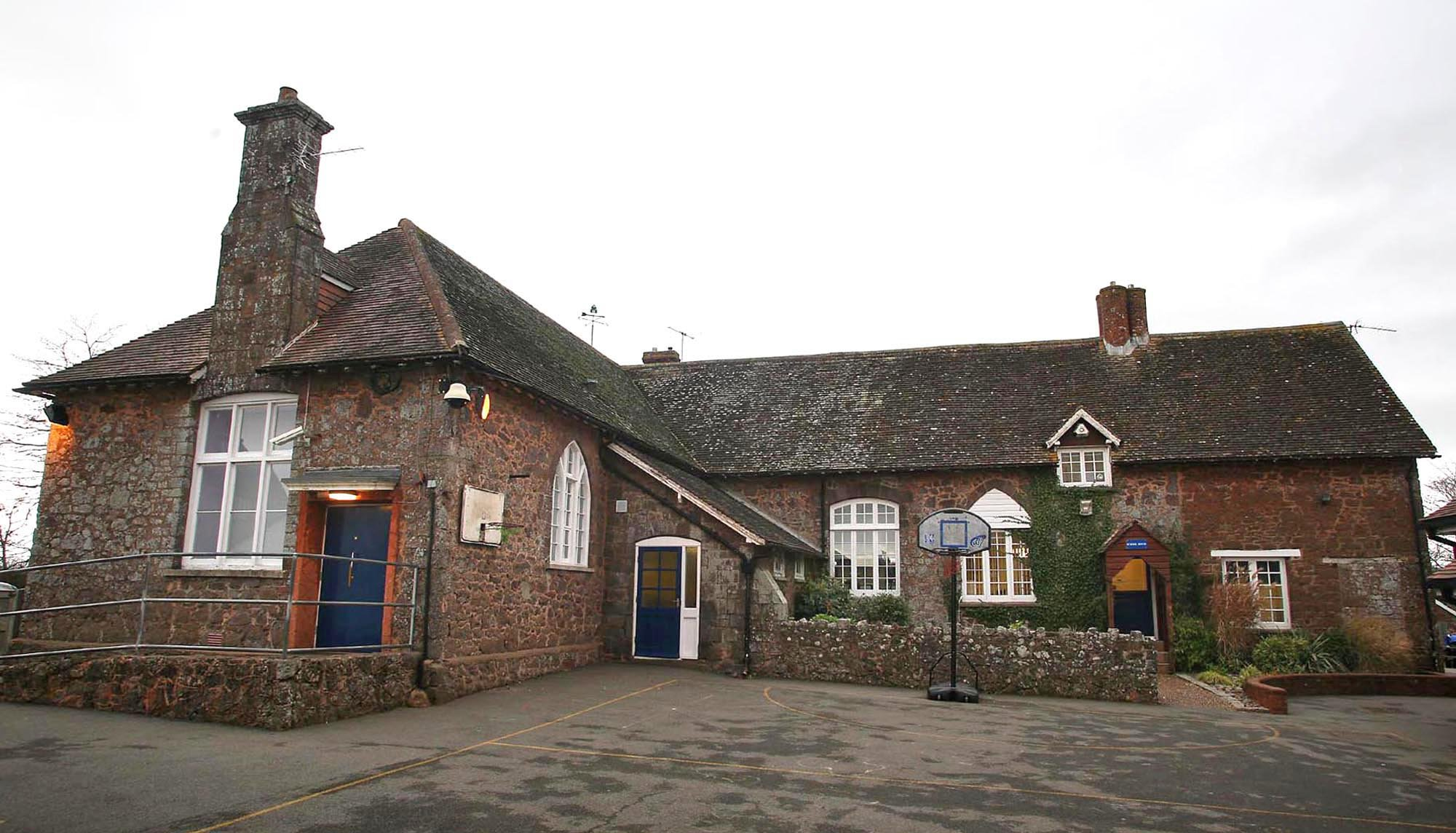 """PIC: APEX 13/09/2018 A Norovirus outbreak in two schools has seen 45 pupils sent home with the severe vomiting bug. Westclyst and Broadclyst Primary School in Devon saw the bug spread through its pupils with parents claiming children were leaving school carrying sick buckets. The two schools currently share the same site at Broadclyst near Exeter. One parent said it was """"like something from a horror film"""" when she went to collect her four-year-old son at the end of the day. Westclyst and Broadclyst Schools are working with Public Health England to manage the outbreak. It's understood more schools in the area have also been affected. Norovirus, also known as the winter vomiting bug, is the most common stomach bug in the UK, affecting people of all ages. This file picture shows a view of Broadclyst Primary School. SEE STORY BY APEX NEWS - 01392 823144 ---------------------------------------------------- APEX NEWS AND PICTURES NEWS DESK: 01392 823144 PICTURE DESK: 01392 823145"""
