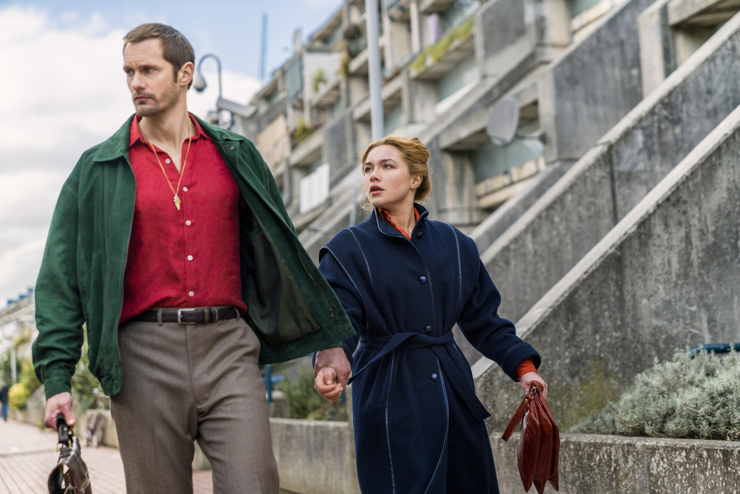 "This image released by AMC shows Alexander Skarsgard, left, and Florence Pugh in a scene from the series ""The Little Drummer Girl,"" premiering on Nov. 19. (Jonathan Olley/AMC/Ink Factory via AP)"