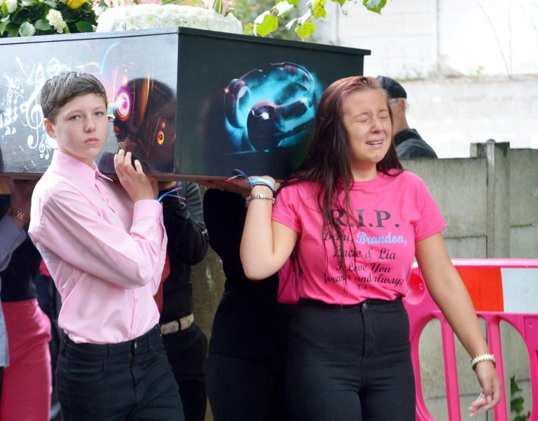 The joint funeral of four children who died in a petrol bomb attack takes place at St Paul?s Church in Walkden, Greater Manchester. September 14, 2018. See ROSS PARRY story RPYFUNERAL. Demi Pearson, 14, Brandon, 8, Lacie, 7, and Lia,3, all died in the devastating attack at their home in Salford, Greater Manchester, last December, and their mother Michelle Pearson, 36, was badly injured in the fire. The funeral, which will be held today, September 14, 2018, will begin with a procession in the street where the youngsters died, before a minute's silence that will be held at the school attended by two of the children. All four children will be buried together, with little Lia in a Peppa Pig coffin because of her love for the show. The funeral will take place at St Paul?s Church in Walkden, where hundreds of people are expected to attend the service, with a screen and speakers outside the church for anyone unable to fit inside. The children?s coffins were taken to the funeral by horse-drawn carriages which will leave their home on Jackson Street at 10a