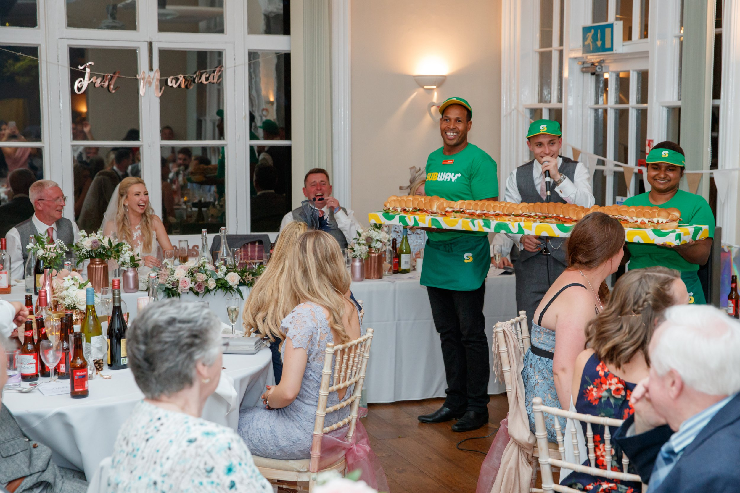 Subway Sandwich Artists Justin Pringle and Yasoda Jayaweera deliver a BMT Giant Sub to the wedding reception of James and Lucinda Coad at Abbotts Hill School in Hemel Hempstead. Three Giant Subs, each measuring six-foot in length and designed to feed up to 25 people, were created for the reception on Saturday 15 September. Featuring: Justin Pringle, Yasoda Jayaweera Where: Hemel Hempstead, Hertfordshire, United Kingdom When: 15 Sep 2018 Credit: Ben Queenborough/PinPep/WENN.com