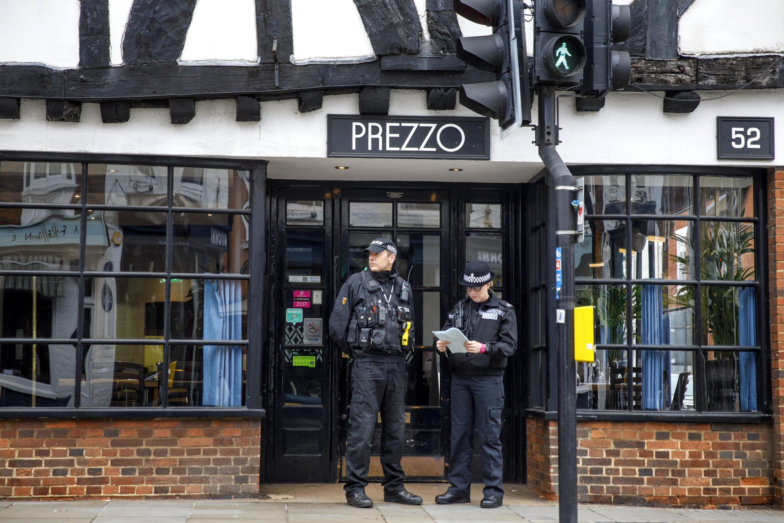 epa07026672 Police officers stand guard outside a Prezzo restaurant in Salisbury, Britain, 17 September 2018, where a 'medical incident' was reported a day earlier. According to reports, police sealed off as a precautionary measure a Prezzo restaurant in Salisbury and surroundings following a 'medical incident' on 16 September, reportedly involving a man and a woman, who were taken ill. According to emergency services, the two persons were conscious and being treated at the scene. The town was in the spotlight in March 2018, when former Russian spy Sergei Skripal and his daughter Yulia became seriously ill in Salisbury after allegedly being exposed to Novichok nerve agent. EPA/TOLGA AKMEN