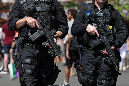 Armed British police officers carry their weapons as they patrol at The All England Tennis Club in Wimbledon, southwest London, on July 2, 2018, on the first day of the 2018 Wimbledon Championships tennis tournament. (Photo by DANIEL LEAL-OLIVAS / AFP) / RESTRICTED TO EDITORIAL USE (Photo credit should read DANIEL LEAL-OLIVAS/AFP/Getty Images)
