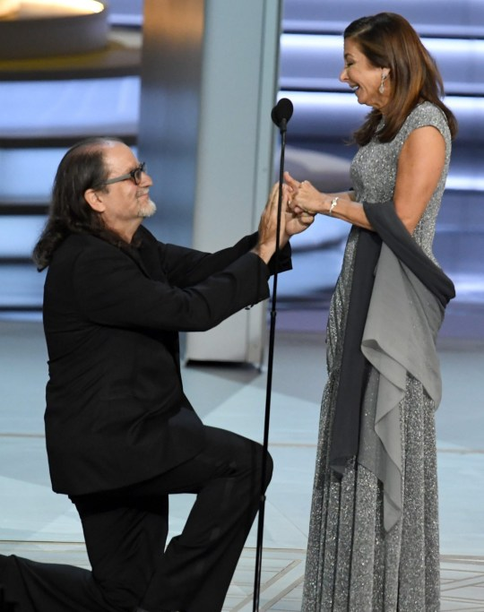 LOS ANGELES, CA - SEPTEMBER 17: Glenn Weiss (L), winner of the Outstanding Directing for a Variety Special award for 'The Oscars,' proposes marriage to Jan Svendsen onstage during the 70th Emmy Awards at Microsoft Theater on September 17, 2018 in Los Angeles, California. (Photo by Kevin Winter/Getty Images)