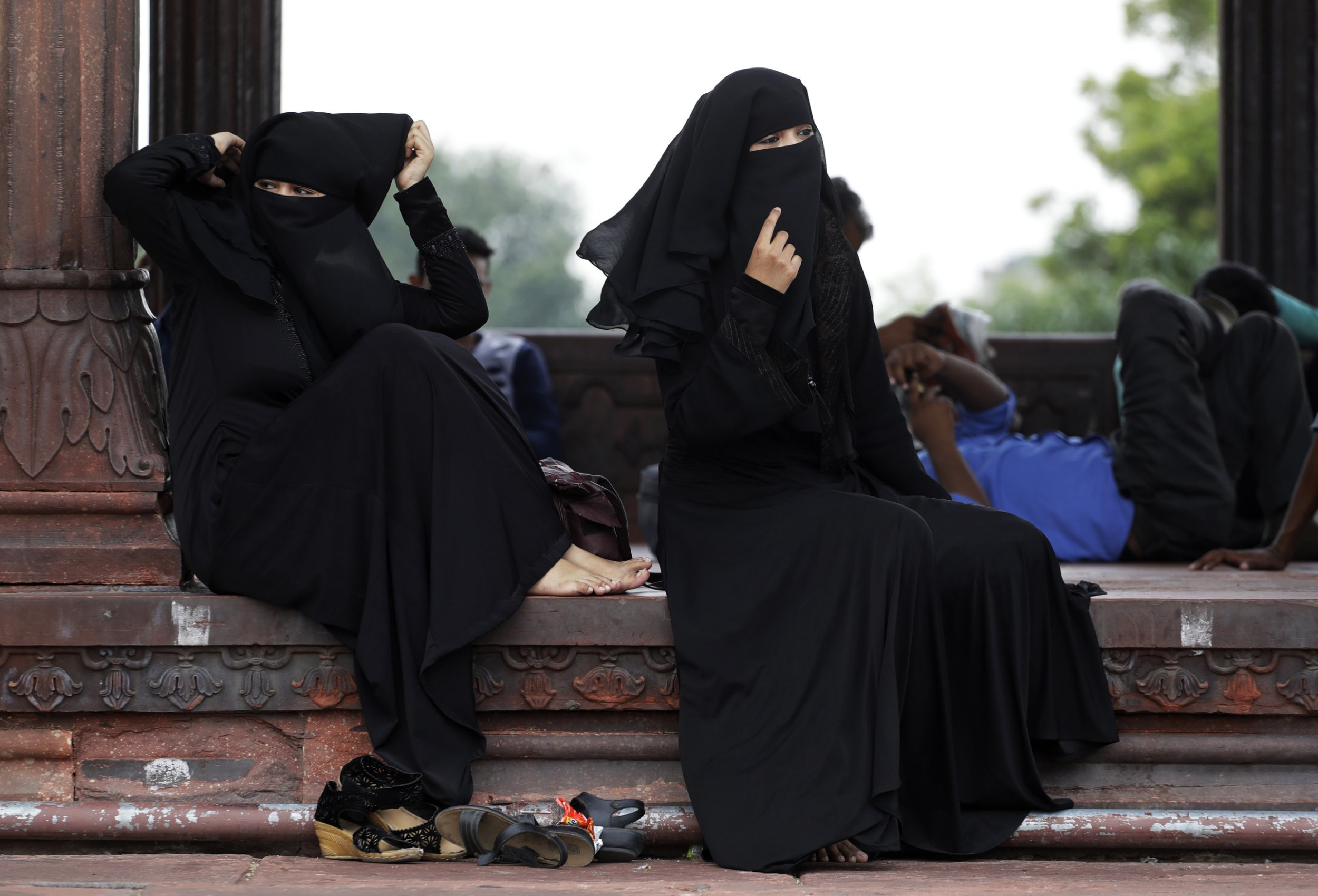 "FILE - In this Aug. 22, 2017 file photo, Indian Muslim women rest inside Jama Masjid mosque in New Delhi, India. India's government on Wednesday, Sept. 19, 2018, approved an ordinance to implement a top court ruling striking down the Muslim practice that allows men to instantly divorce. The government decision came after it failed to get approval of Parliament a year after the court ruled that the practice of triple ""talaq"" violated the constitutional rights of Muslim women. (AP Photo/Tsering Topgyal, File)"