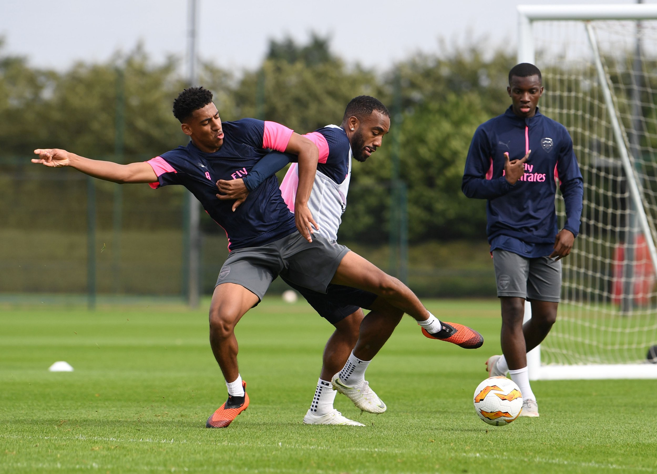 ST ALBANS, ENGLAND - SEPTEMBER 19: (L-R) Domonic Thompson and Alex Lacazette of Arsenal during a training session at London Colney on September 19, 2018 in St Albans, England. (Photo by Stuart MacFarlane/Arsenal FC via Getty Images)
