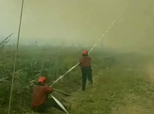 'Fire tornado' steals firefighter's hose picture: PA METROGRAB