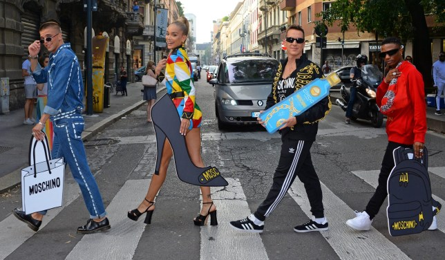 MILAN, ITALY - SEPTEMBER 19: (L to R) River Viiperi, Jasmine Sanders aka Golden Barbie, Jeremy Scott and WizKid stop traffic launching the CIROC x Moschino collaboration during Milan Fashion Week in the centre of Milan. CIROC luxury vodka has partnered with Italian fashion house Moschino, bringing together fashion's most playful brands. (Photo by David M. Benett/Dave Benett/Getty Images for CIROC)