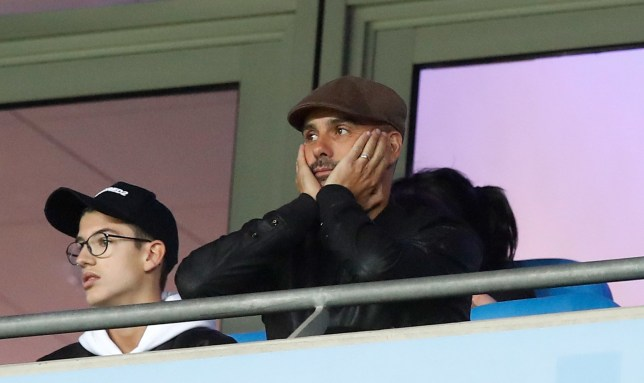Manchester City manager Pep Guardiola appears dejected in the stands during the UEFA Champions League, Group F match at the Etihad Stadium, Manchester. PRESS ASSOCIATION Photo. Picture date: Wednesday September 19, 2018. See PA story SOCCER Man City. Photo credit should read: Martin Rickett/PA Wire