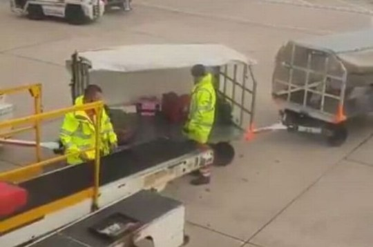 One bag is flung through the air with such force it flies through the back of the trolley and onto the ground