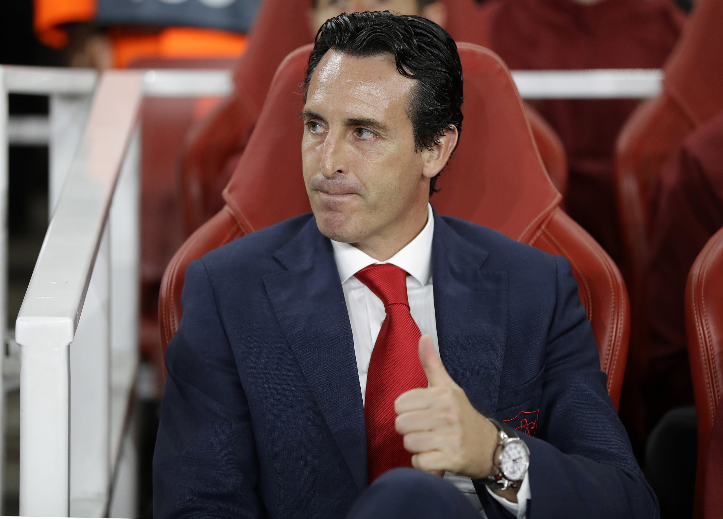 Arsenal's manager Unai Emery shows thumb up on his bench prior the Europa League Group E soccer match between Arsenal and Vorskla in London, England, Thursday, Sept. 20, 2018. (AP Photo/Kirsty Wigglesworth)