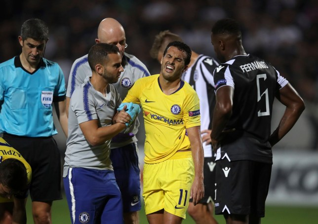 Chelsea's Pedro Rodriguez, center, leaves the field with medics during a Group L Europa League soccer match between PAOK and Chelsea at Toumba stadium in the northern Greek port city of Thessaloniki, Thursday, Sept. 20, 2018. (AP Photo/Thanassis Stavrakis)