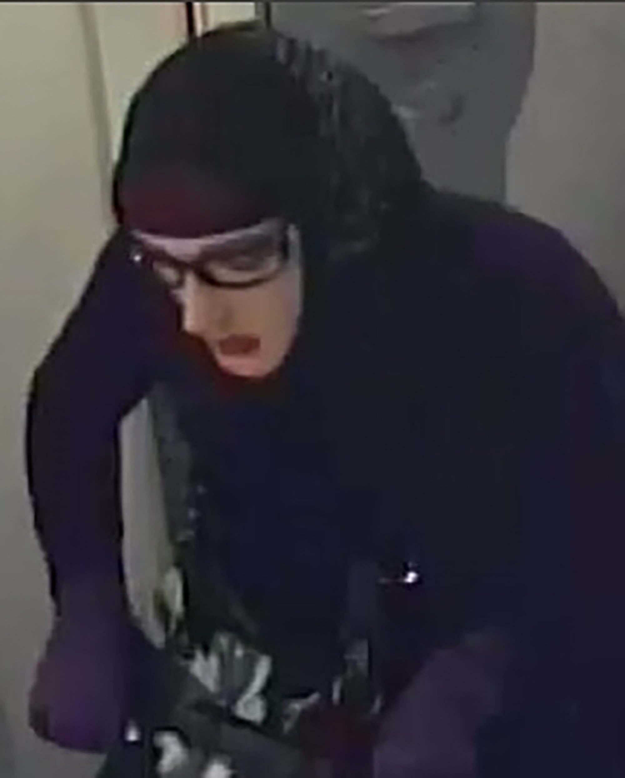 Pic shows: The hijab bank robber with the trolley Police have offered almost 2,000 GBP as a reward for any clues about the identity of a male bank robber dressed as a Muslim woman in a hijab after a similar suspect was also arrested. Austrian police have issued a reward of 2,000 EUR (1,771 GBP) in the hope witnesses will come forward with clues about the notorious hijab bank robber who carried out a raid on the Turkish DenizBank bank in Linz in the state of Upper Austria. They have issued new pictures showing the man disguised as a Muslim woman wearing a hijab and pinstripe trousers, carrying a shopping trolley and a shoulder bag. The suspected robber is wearing glasses and a latex mask with red lips. He reportedly robbed the bank in Linz by threatening an employee with a pistol, taking the money out of the register and fleeing on a grey scooter. In the Austrian capital Vienna, he allegedly attempted to rob a bank in the same manner with a pistol but only managed to frighten employees who began screaming. He is said to have then sprayed them with pepper spray and before fleeing the scene. The perpetrator has been described as being between the ages of 20 to 35 with a slender stature and measuring 1.80 to 1.90 metres (5.9 to 6.23 feet) tall. The reward comes after police arrested a 35-year-old man last month on suspicion of robbing a Turkish bank in Vienna also dressed as a Muslim woman in a hijab and carrying a golden coloured pistol. He allegedly handed over a handwritten note demanding cash from the Vienna bank. He escaped with thousands of euros in cash but police were tipped off to his identity when he was snapped in a small park nearby by a witness who had followed him. In the park, he had no mask on and was sitting on a bench in a pink shirt and shorts. Police have said that CCTV footage indicated there were at least two different men who have been dressing up as Muslim women in hijabs in order to carry out at least four robberies in Vienna and Lin