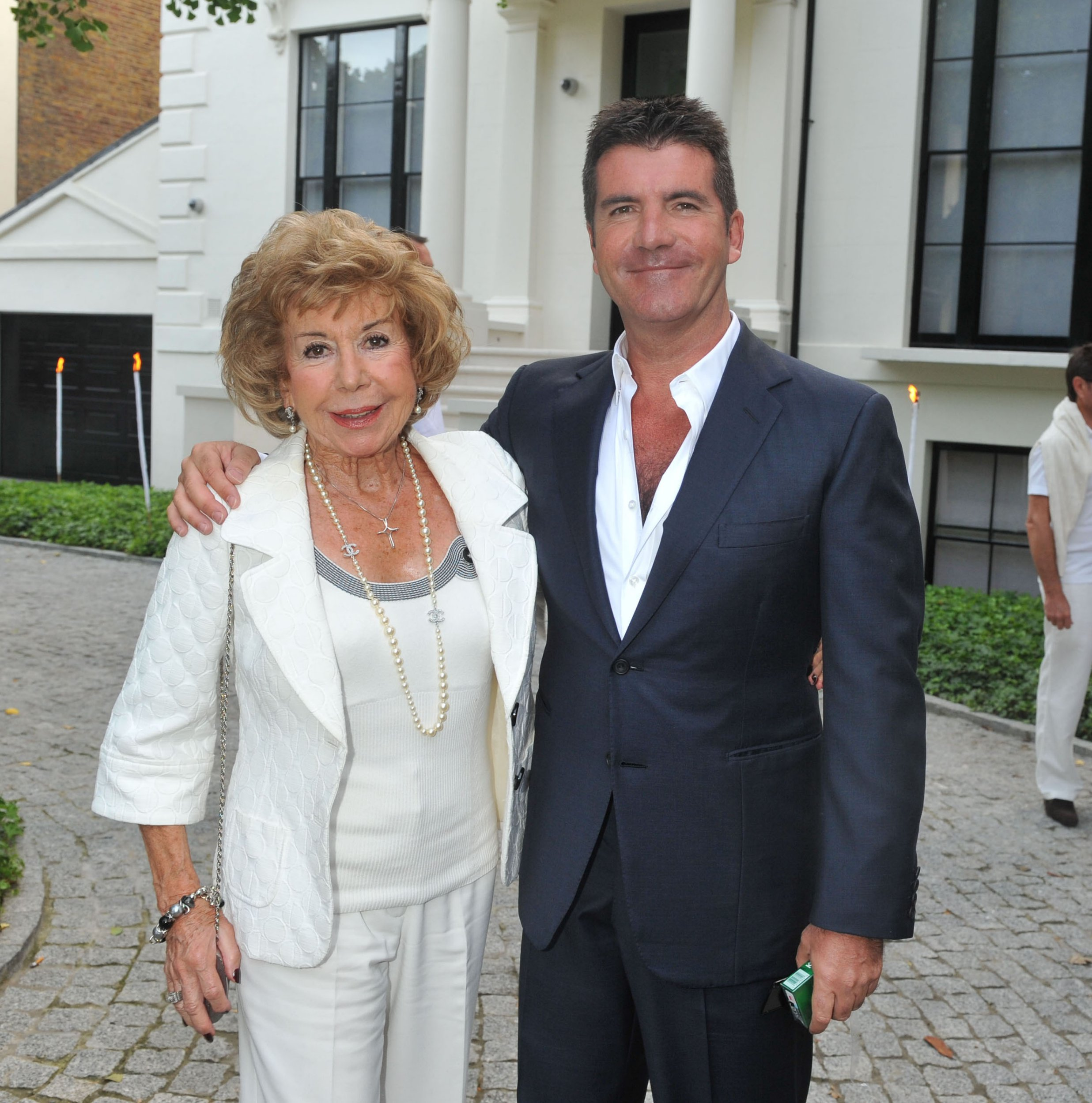 Mandatory Credit: Photo by Alan Davidson/REX/Shutterstock (7547762bk) Jackie St Clair and Simon Cowell Joint 50th Birthday Party at Her Home in Holland Park London Simon Cowell with His Mother Julie Brett Jiont 50th Birthday Party - 25 Jul 2009