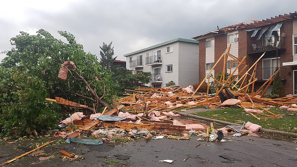Destroyed buildings and cars are seen in Mont-Bleu, Gatineau, Quebec, close to Ottawa after a tornado shattered Canada's capital on September 21, 2018. - A tornado sparked chaos near the Canadian capital Ottawa on Friday, injuring dozens as homes were damaged, cars flipped over, and over 130,000 people left without power, local media said. Meteorologists reported gusts whipped up to around 120 miles per hour (190 kilometers per hour), with the city of Gatineau, about five miles north of the capital, taking the brunt. (Photo by Vincent-Carl LERICHE / AFP) / RESTRICTED TO EDITORIAL USE MANDATORY CREDIT ?? AFP PHOTO / VINCENT-CARL LERICHE] ?? - NO MARKETING NO ADVERTISING CAMPAIGNS DISTRIBUTED AS A SERVICE TO CLIENTS [- NO ARCHIVE ]VINCENT-CARL LERICHE/AFP/Getty Images