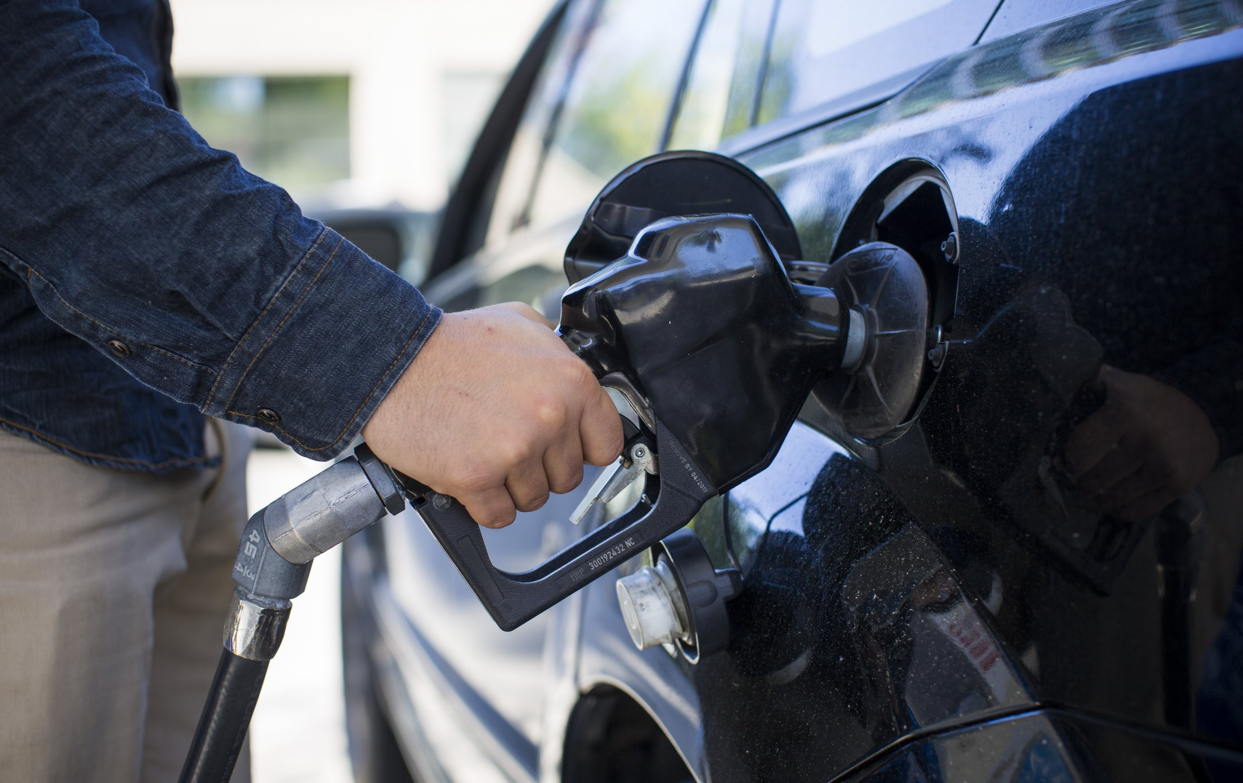 A man fills a car with fuel at an Esso gas station in Vancouver, British Columbia, Canada, on Friday, May 6, 2016. The worst wildfire in Alberta history is boosting Canadian crude prices as oil companies evacuate workers and shut in output. Photographer: Ben Nelms/Bloomberg via Getty Images