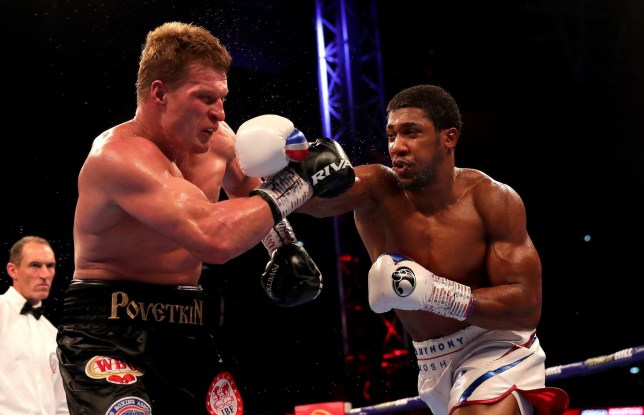 LONDON, ENGLAND - SEPTEMBER 22: Anthony Joshua punches Alexander Povetkin during the IBF, WBA Super, WBO & IBO World Heavyweight Championship title fight between Anthony Joshua and Alexander Povetkin at Wembley Stadium on September 22, 2018 in London, England. (Photo by Richard Heathcote/Getty Images)