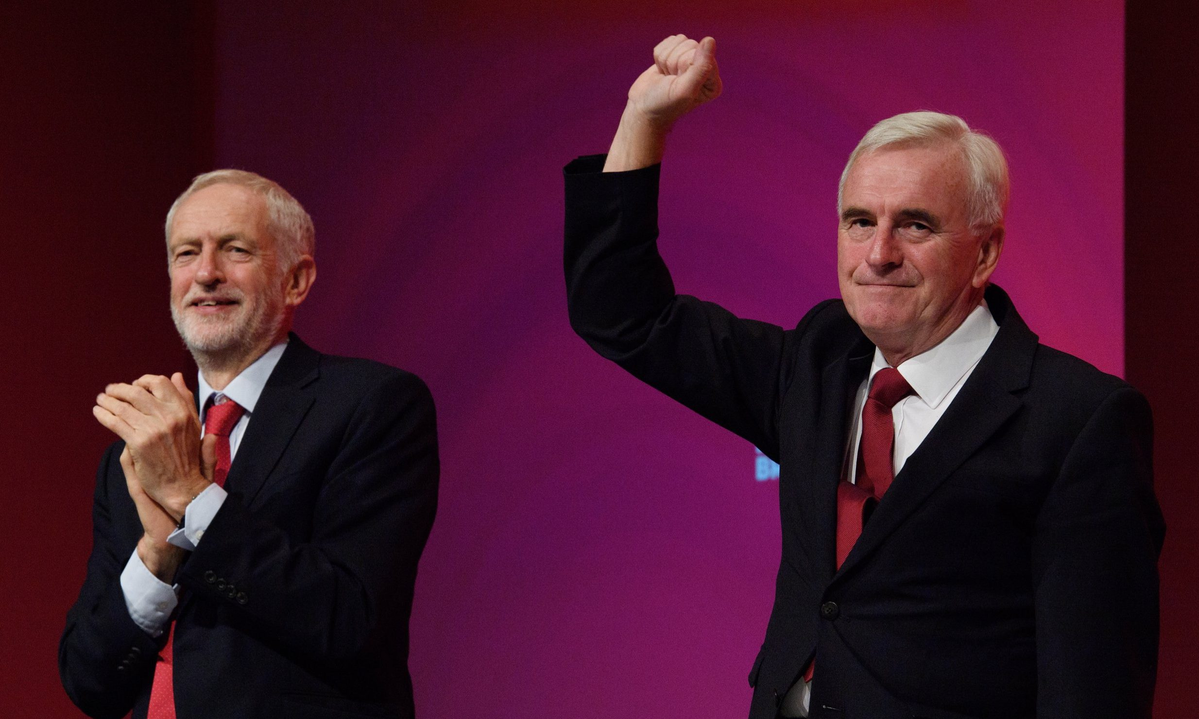 LIVERPOOL, ENGLAND - SEPTEMBER 24: Labour Party leader Jeremy Corbyn looks on as Shadow Chancellor of the Exchequer John McDonnell receives applause following his address to delegates in the Exhibition Centre Liverpool during day two of the annual Labour Party conference on September 24, 2018 in Liverpool, England. Labour's official slogan for the conference is ??Rebuilding Britain, for the many, not the few??. (Photo by Leon Neal/Getty Images) ***BESTPIX***