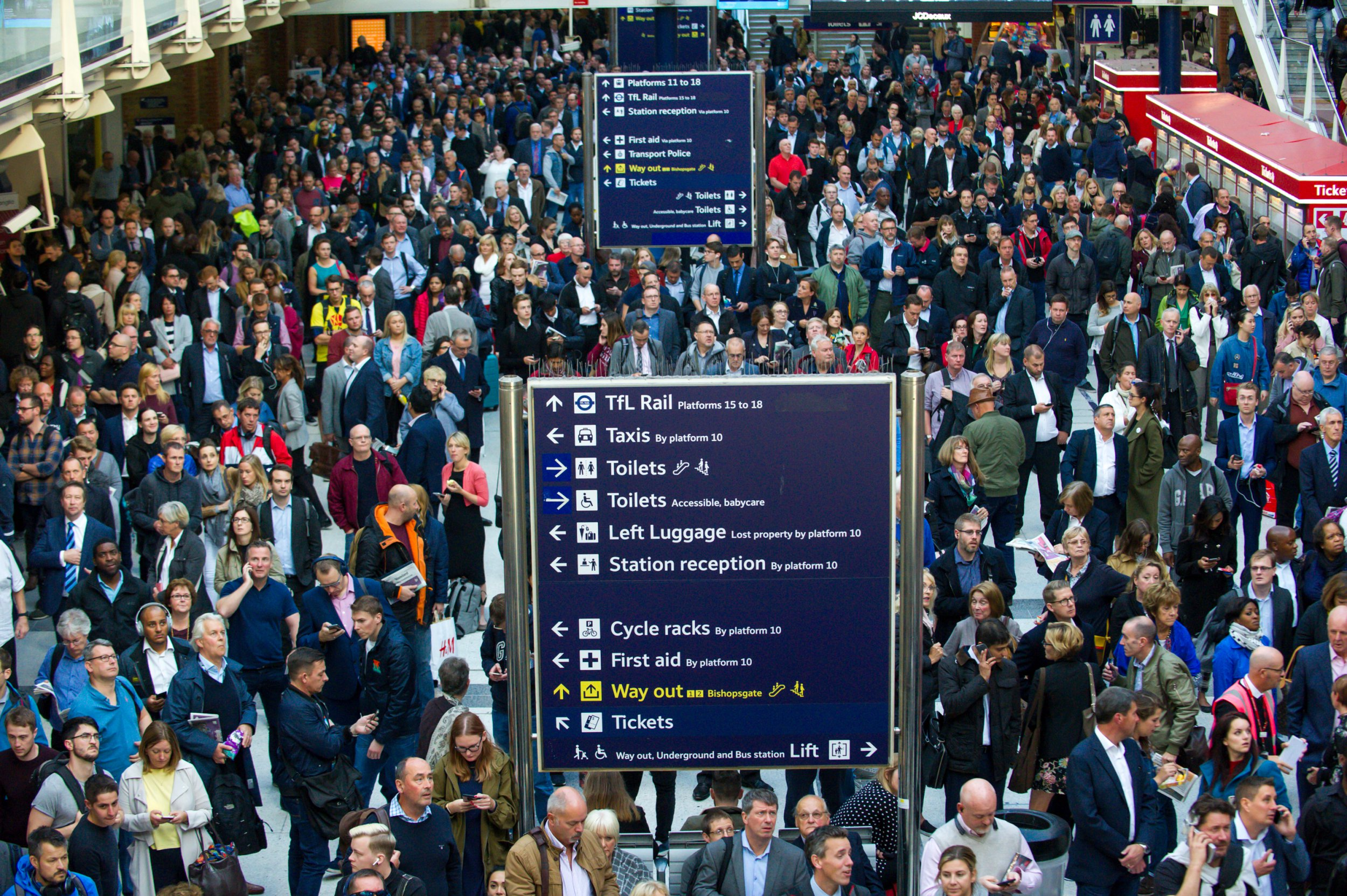 Image ??Licensed to i-Images Picture Agency. 24/09/2018. London, United Kingdom. London Liverpool Street travel chaos. View of the Liverpool Street Station. Hundreds of commuters are gathered in front of the timetables screens waiting to the end of the chaos. Abellio Greater Anglia told passengers not to travel after the person was hit between Goodmayes and Romford. All trains are at a standstill unable to move on the crucial part of the network which connects London with all other destinations. All train services between London Liverpool Street and Shenfield, Southend Victoria, Braintree, Colchester, Ipswich and Norwich are affected. Delays of up to two hours are expected while emergency services deal with the incident. Picture by Gustavo Valiente / i-Images