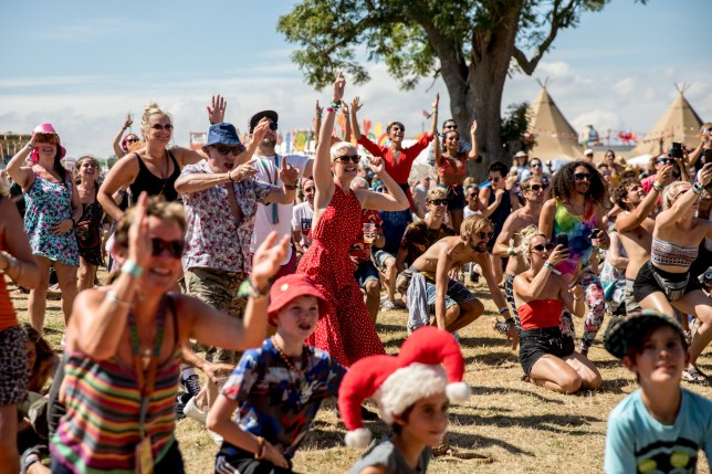 EAST LULWORTH, ENGLAND - AUGUST 03: People watch a band on the main stage at Bestival, at Lulworth Castle near East Lulworth on August 3, 2018 in Dorset, England. The recent heatwave looks set to return to some parts of the UK, as an 'Iberian plume' sweeps Europe and Britain, producing what could be be the hottest day in European history. Nicknamed Furnace Friday, UK temperatures could be as high as 32C (89.6F) in the south-east of England, whilst in continental Europe, forecasters are warning temperatures could be has high as 48C (118F). Described by the organisers as a boutique festival, Bestival was started in 2004 by DJ Rob da Bank, on the Isle of Wight. In 2018 it moved to the Lulworth Estate, which also hosts its family-friendly sister event, Camp Bestival. (Photo by Matt Cardy/Getty Images)