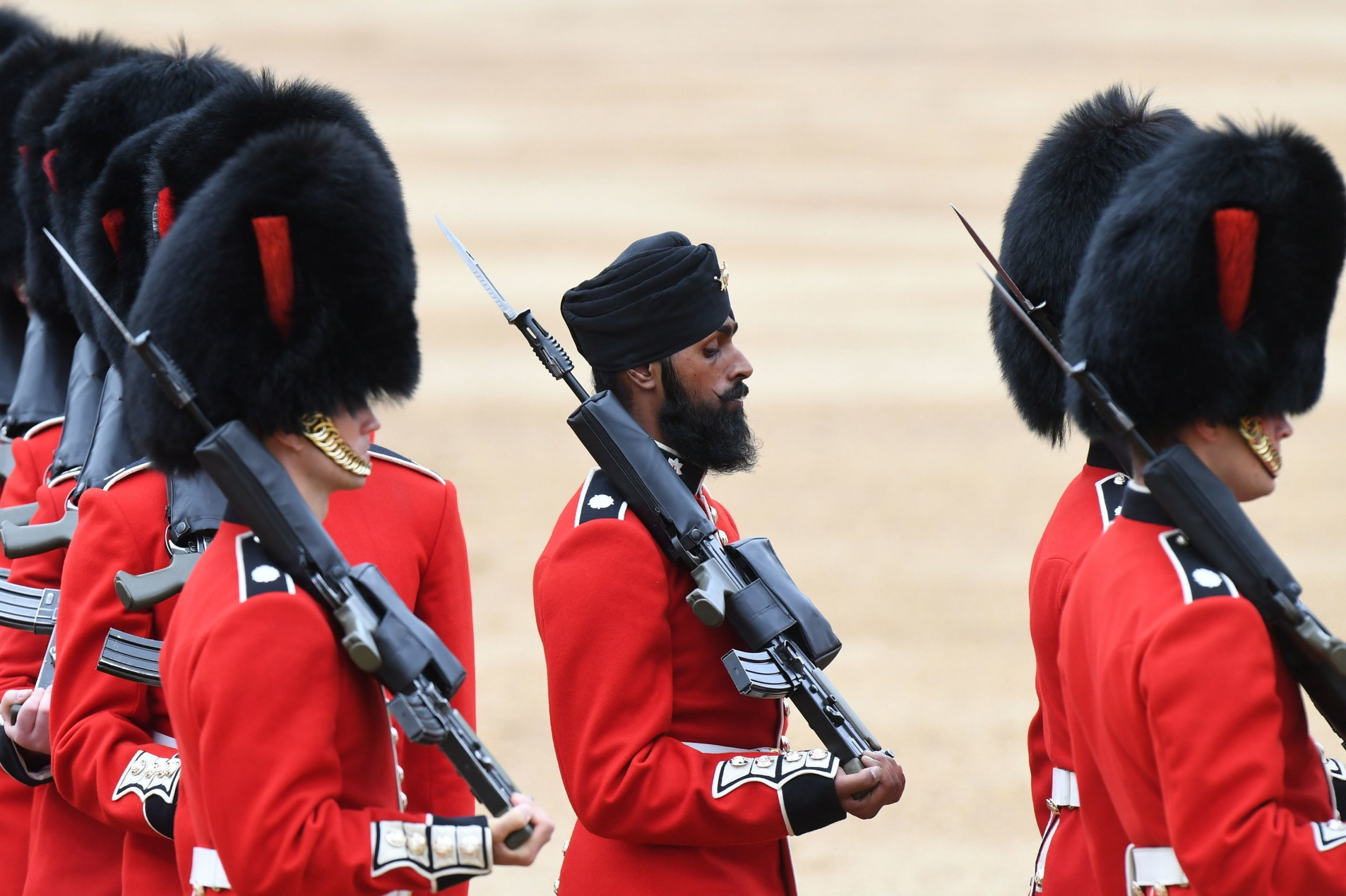 "Embargoed to 0001 Saturday June 9 File photo dated 2/6/2018 of Coldstream Guards soldier Charanpreet Singh Lall wearing a turban during a rehearsal for Trooping the Colour and who has said that he hopes it is looked upon as a ""new change in history""."
