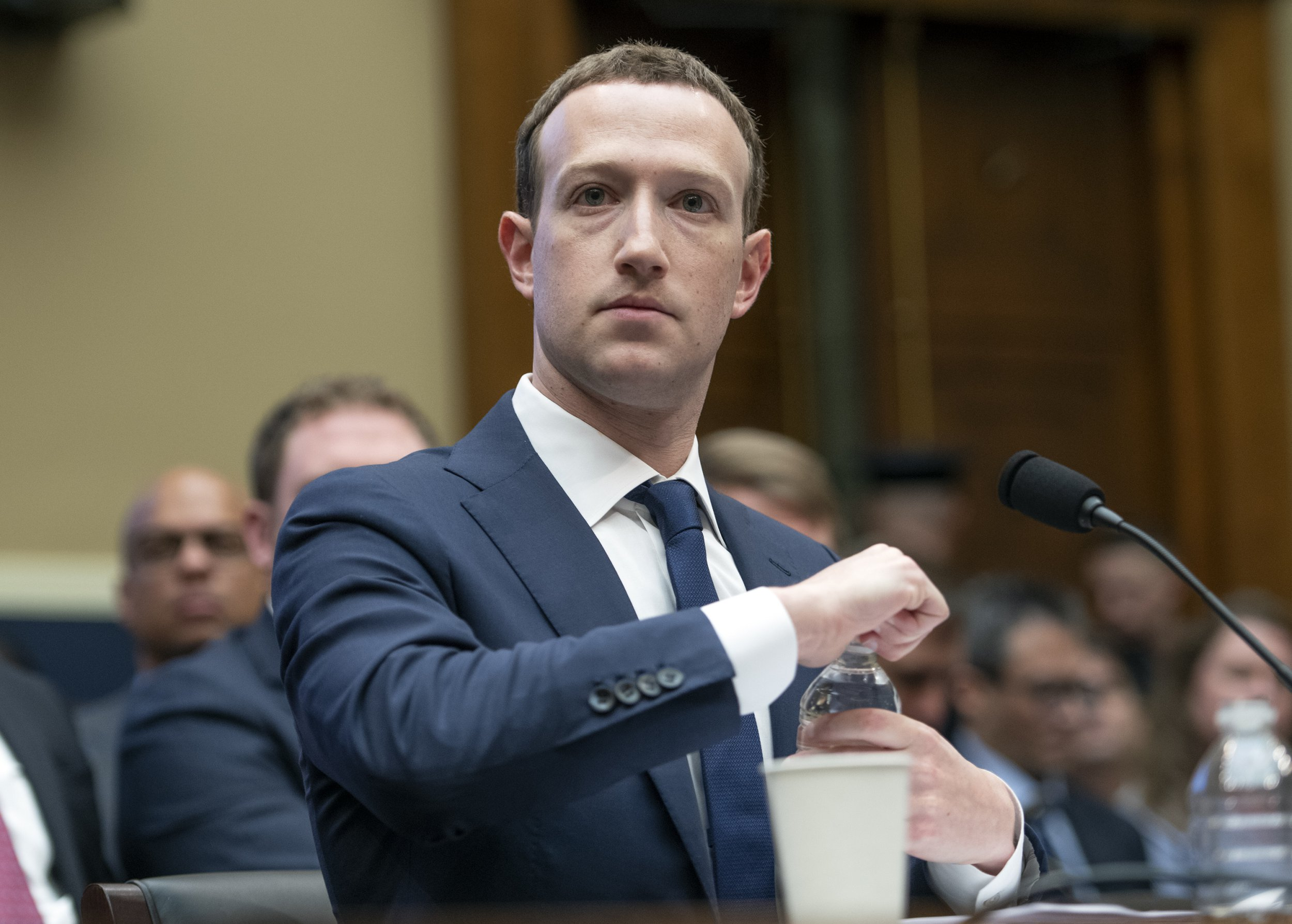 """Mark Zuckerberg, Co-Founder and CEO of Facebook, takes a drink of water as he testifies before a meeting of the United States House Committee on Energy and Commerce during a hearing on """"Facebook: Transparency and Use of Consumer Data,"""" on Capitol Hill in Washington, DC on Wednesday, April 11, 2018. Credit: Ron Sachs / CNP (RESTRICTION: NO New York or New Jersey Newspapers or newspapers within a 75 mile radius of New York City) -NO WIRE SERVICE- Photo: Ron Sachs/Consolidated/dpa"""