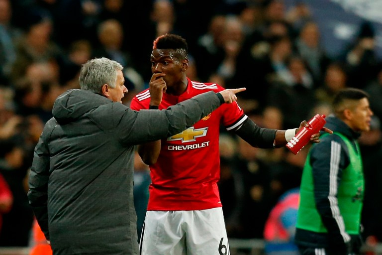 (FILES) In this file photo taken on January 31, 2018 Manchester United's Portuguese manager Jose Mourinho (L) talks with Manchester United's French midfielder Paul Pogba (R) after the second Tottenham goal goes in during the English Premier League football match between Tottenham Hotspur and Manchester United at Wembley Stadium in London. - Paul Pogba has been told by Manchester United manager Jose Mourinho he will never captain the club again while the Portuguese remains in charge, according to reports on September 25, 2018, as tensions between United's star midfielder and manager continue to rise. (Photo by Ian KINGTON / IKIMAGES / AFP) / RESTRICTED TO EDITORIAL USE. No use with unauthorized audio, video, data, fixture lists, club/league logos or 'live' services. Online in-match use limited to 45 images, no video emulation. No use in betting, games or single club/league/player publications. / IAN KINGTON/AFP/Getty Images