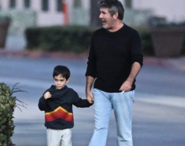Simon Cowell and son Eric see walking in Malibu. ***SPECIAL INSTRUCTIONS*** Please pixelate children's faces before publication.***. 25 Sep 2018 Pictured: Simon Cowell and son Eric. Photo credit: MEGA TheMegaAgency.com +1 888 505 6342