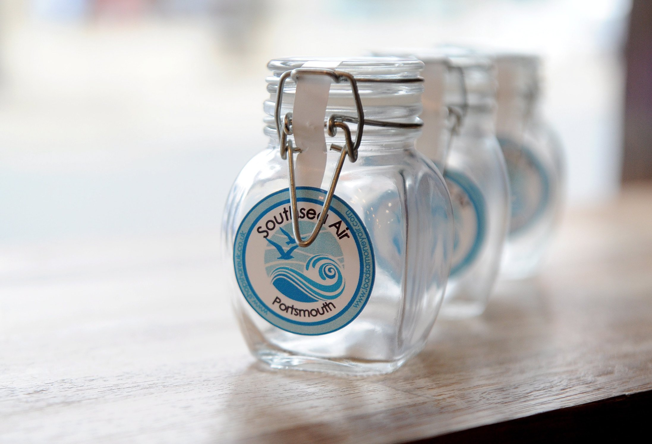 """Pictured: The jar of Southsea Air on sale at Aurora Coffee Shop, Southsea. An entrepreneur selling jars of 'authentic' seaside air for ?10 a time today denied he is conning the public. Businessman Richard Reynolds, 54, waves empty jars around on a beach then seals them before selling them on. Each of the jars containing 105ml of air """"caught"""" in Southsea, Hants, is then labelled before being advertised on the internet. It comes in four varieties including Southsea Air, Gunwharf Quays Air and India Quay Air, which is taken from the nearby marina of Port Solent. SEE OUR COPY FOR DETAILS. ? Portsmouth News/Solent News & Photo Agency UK +44 (0) 2380 458800"""