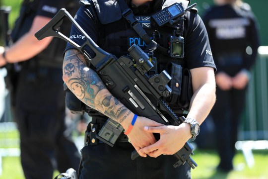 Detail of a police officer holding a gun on Long Walk ahead of the wedding of Prince Harry and Meghan Markle in St George's Chapel in Windsor Castle. PRESS ASSOCIATION Photo. Picture date: Saturday May 19, 2018. See PA story ROYAL Wedding. Photo credit should read: Mike Egerton/PA Wire