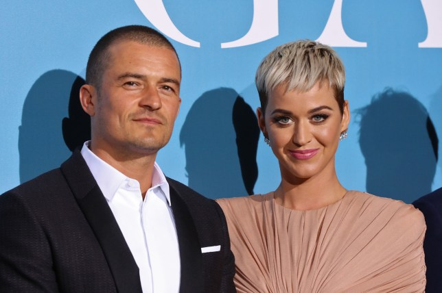 British actor Orlando Bloom (L) and US singer Katy Perry pose upon their arrival at the 2nd Monte-Carlo Gala for the Global Ocean 2018 held in Monaco on September 26, 2018. - On September 26, 2018, the Prince Albert II of Monaco Foundation will hold its second Monte-Carlo Gala for the Global Ocean, a major fundraising event in the heart of Monte Carlo, in order to support its worldwide initiatives in favor of a sustainable ocean, a crucial issue calling for immediate and collective action. (Photo by Valery HACHE / AFP)VALERY HACHE/AFP/Getty Images