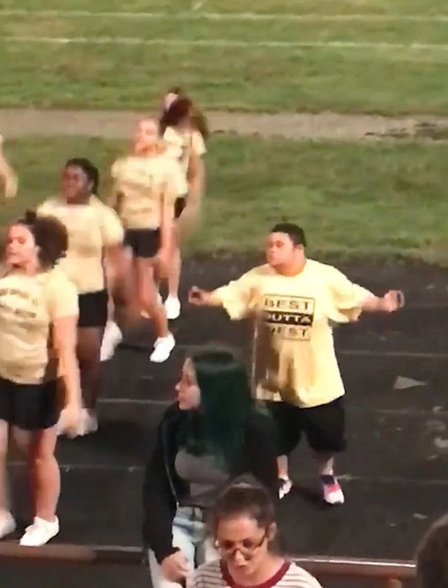 Collect photos from the family. Glenn perforning withnthe cheer leaders. The horrified family of a high school cheerleader with Down?s Syndrome say he was barred from training sessions because he didn?t fit with the squad?s ?image?.See story NYCHEER. Glenn Wilson, 17, was delighted when he was picked to join the West High School cheer team earlier this year and began practising his moves straight away. But his family grew concerned when his starter kit containing training schedules and uniform costs didn?t arrive during the summer holiday. Glenn?s uncle Ray Valentine, 47, contacted the school in Columbus, Ohio, USA, and claims he was told Glenn was not welcome on her team. He claims the cheerleading coach would not fit with the ?image? of the squad and that she had no experience of working with children with special needs. The teenager has since been allowed to perform at his school?s football games, most recently on September 21, but has only been allowed to train with the squad since September 24. The Columbus Board of Education is investigating the incident and admitted mistakes may have been made.